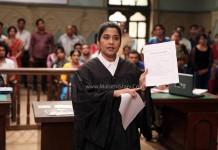 Actress Renuka Shahane as lawyer - Janiva Marathi Movie Still Photos