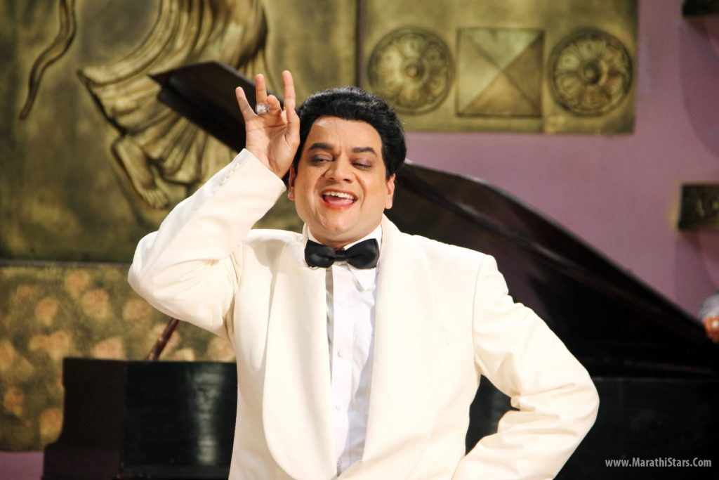 Mangesh Desai as Bhagwan Dada